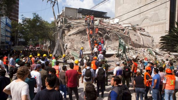 Rescuers in desparate search for survivors after the collapse of of school