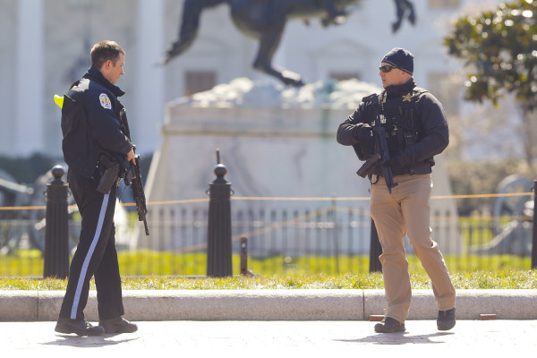 Law enforcement Patrols after Man commits suicide Outside the White House